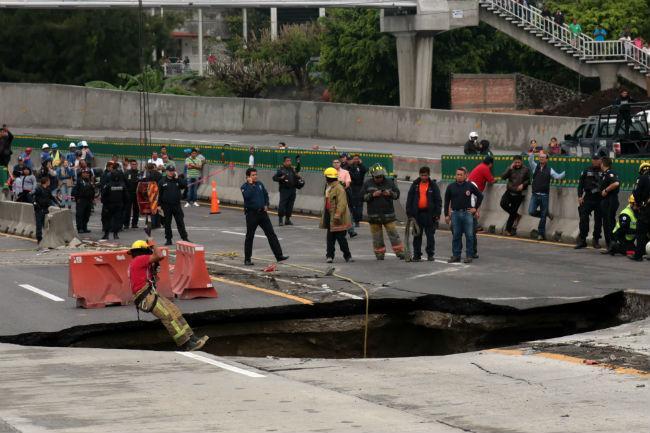 Familiares de muertos por socavón en Cuernavaca rechazan indemnización