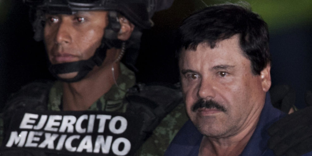 """HOLD FOR STORY. FILE. - In this Jan. 8, 2016 file photo, Mexican drug lord Joaquin """"El Chapo"""" Guzman, right, is escorted by soldiers and marines to a waiting helicopter, at a federal hangar in Mexico City, after hjs arrest. The world's most wanted drug lord was recaptured by Mexican marines six months after he fled through a tunnel from a maximum security prison in an escape that deeply embarrassed the government and strained ties with the United States. Now that a Mexican judge has ruled that extradition proceedings for """"El Chapo"""" can go  forward, the U.S. Justice Department must choose which one of the competing jurisdictions will win the prize of putting him on trial. (AP Photo/Marco Ugarte, File)"""