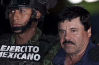 "HOLD FOR STORY. FILE. - In this Jan. 8, 2016 file photo, Mexican drug lord Joaquin ""El Chapo"" Guzman, right, is escorted by soldiers and marines to a waiting helicopter, at a federal hangar in Mexico City, after hjs arrest. The world's most wanted drug lord was recaptured by Mexican marines six months after he fled through a tunnel from a maximum security prison in an escape that deeply embarrassed the government and strained ties with the United States. Now that a Mexican judge has ruled that extradition proceedings for ""El Chapo"" can go  forward, the U.S. Justice Department must choose which one of the competing jurisdictions will win the prize of putting him on trial. (AP Photo/Marco Ugarte, File)"