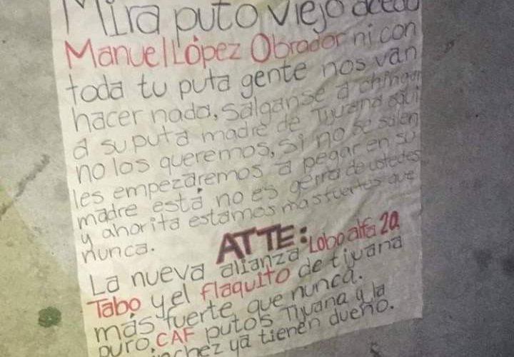 Detienen a guatemalteco por colgar manta con amenazas contra AMLO en Tijuana
