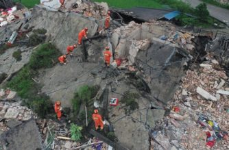 Rescue workers are seen on a collapsed house after earthquakes hit Changning county in Yibin, Sichuan province, China June 18, 2019. REUTERS/Stringer ATTENTION EDITORS - THIS IMAGE WAS PROVIDED BY A THIRD PARTY. CHINA OUT.