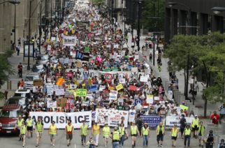CHICAGO, ILLINOIS - JULY 13: Protesters march to offices of the U.S. Immigration and Customs Enforcement on July 13, 2019 in Chicago, Illinois. The rally is calling for an end to criminalization, detention and deportation of migrants ahead of planned ICE raids expected to begin tomorrow.   Nuccio DiNuzzo/Getty Images/AFP