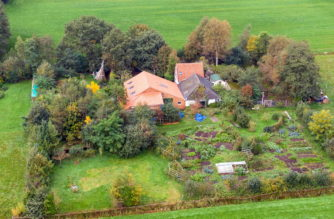 epa07922542 A drone photo of the farm, where a father and six children had been living in the cellar, In Ruinerwold, The Netherlands, 15 October 2019. The family lived in the cellar for years and where waiting for 'the end of time'.  EPA/Wilbert Bijzitter