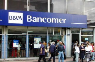 Customers stand outside a branch of Grupo Financiero BBVA Bancomer SA in Mexico Wednesday August 13, 2003. Mexico's largest state has asked the federal government and bank creditors that include a unit of Citigroup Inc. for lower interest payments and more time to repay $3 billion of debt. Photographer: Raul Aguilar/Bloomberg News.