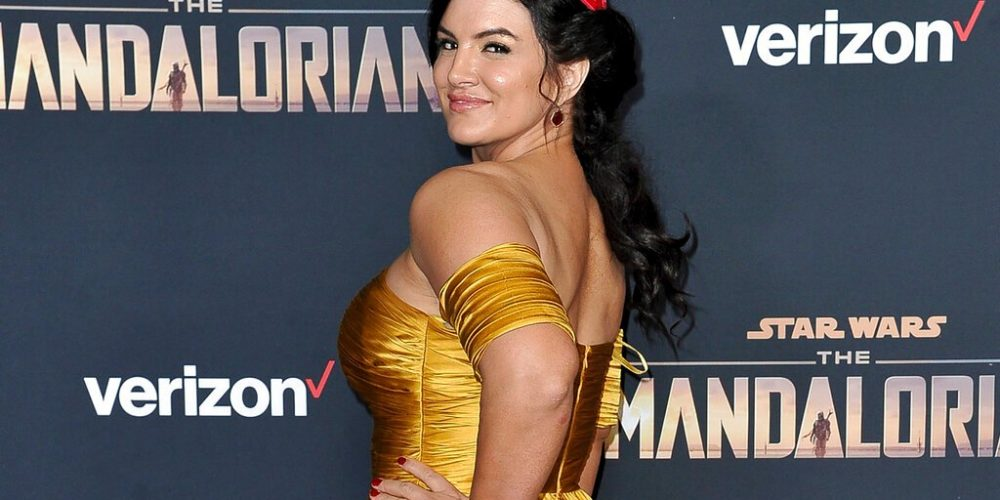 """FILE - In this Wednesday, Nov. 13, 2019, file photo, Gina Carano attends the LA premiere of """"The Mandalorian"""" at the El Capitan Theatre in Los Angeles. In a statement Wednesday, Feb. 10, 2021, Lucasfilm said Carano is no longer a part of """"The Mandalorian"""" cast after many online called for her firing over a social media post that likened the experience of Jews during the Holocaust to the U.S. political climate. (Photo by Richard Shotwell/Invision/AP, File)"""
