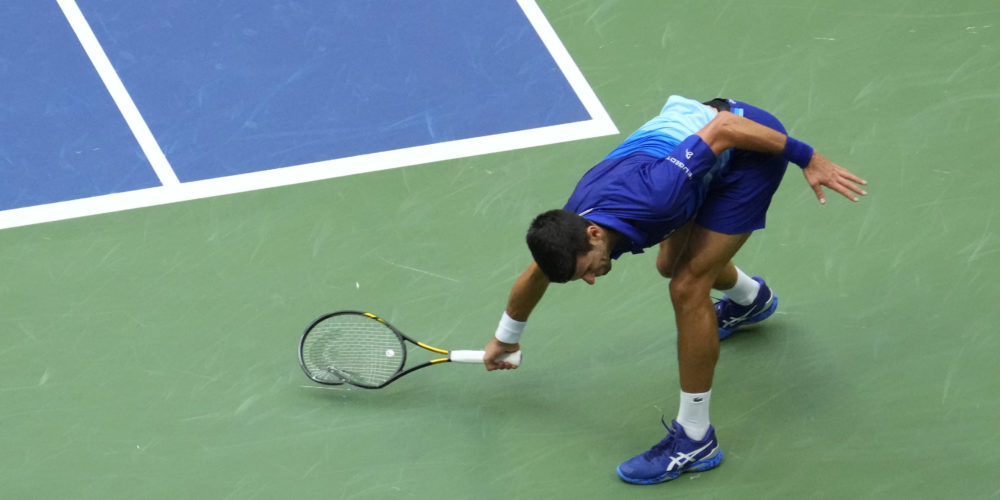 Sep 12, 2021; Flushing, NY, USA; Novak Djokovic of Serbia smashes his racket after losing a point to Daniil Medvedev of Russia in the second set of the men's singles final on day fourteen of the 2021 U.S. Open tennis tournament at USTA Billie Jean King National Tennis Center. Mandatory Credit: Robert Deutsch-USA TODAY Sports
