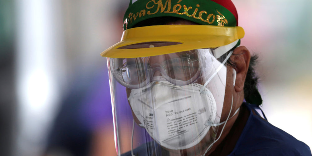 A health worker wearing a protective face mask is seen at a drive-thru testing while the spread of the coronavirus disease (COVID-19) continues, in Monterrey, Mexico April 11, 2020. REUTERS/Daniel Becerril